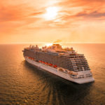 Cruise ship sailing into the sunset on the ocean